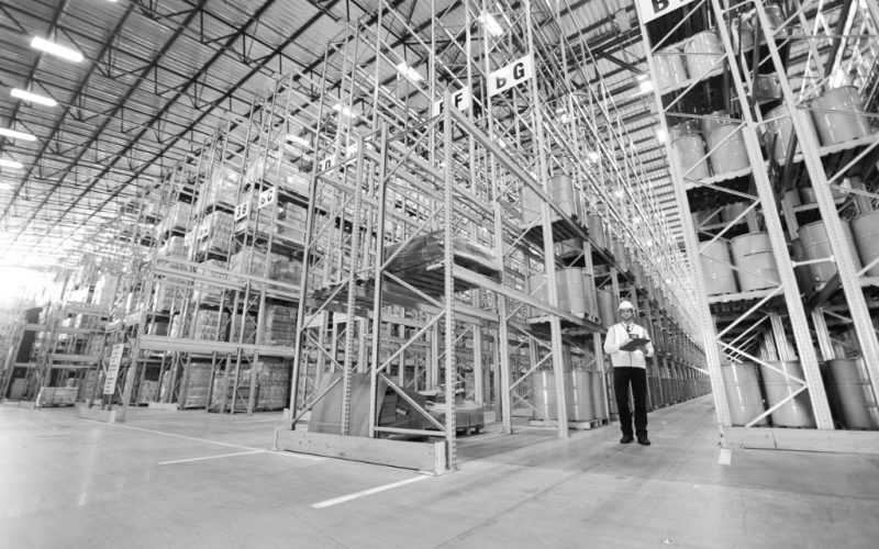 worker-standing-in-warehouse-min